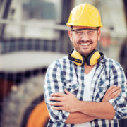 tradesman with arms crossed happy after ABMA accreditation