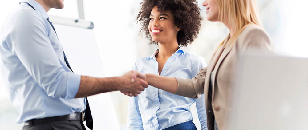body corporate trainers shaking hands with course members
