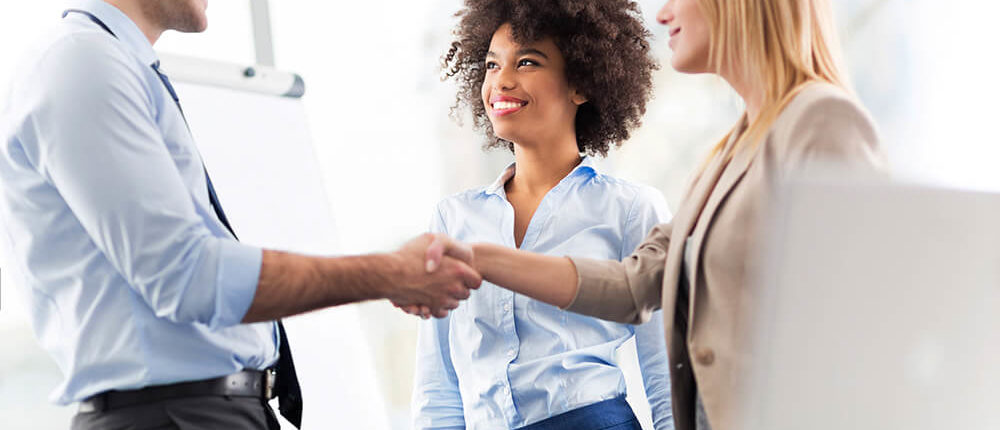 strata trainers shaking hands with property managers